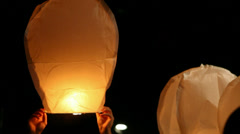 Releasing paper lantern at night Stock Footage