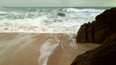 Rough seas breaking onto the beach, Cornwall Stock Footage