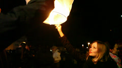 Girl holding and releasing paper lantern Stock Footage
