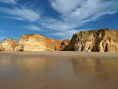 Colourful rocks and wonderful sands on the algarve coast in portugal Stock Photos