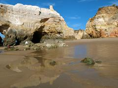 Caves and colourful rock formations on the algarve coast in portugal Stock Photos