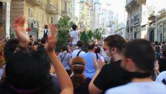People clap as they gather to protest against police brutality at Street Stock Footage