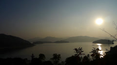 Sunset over mountain & lake. Stock Footage