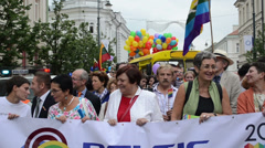 Politics guests people in beginning of gay parade crowd members Stock Footage