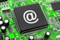 E-mail symbol on computer chip Stock Photos