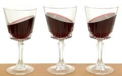 three wineglasses and gravity - stock photo