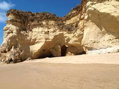 colourful rocks and wonderful sands on the algarve coast - stock photo