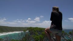 Girl photographing from the Observatory Point at the Great Ocean Drive Stock Footage