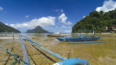 Boats on shore during low tide Philippines time lapse - stock footage