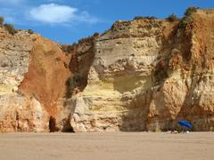 colorful rock cliffs of the algarve in portugal - stock photo