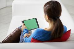Asian girl using touch pad device Stock Photos