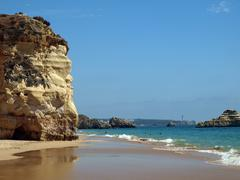 Colourful rocks on the algarve coast Stock Photos