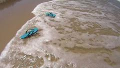 Flip Flops Washed Ashore Stock Footage