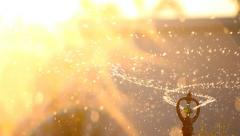 water sprinkler spray watering, dolly shot - stock footage