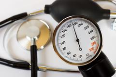 Scale of pressure and stethoscope - stock photo