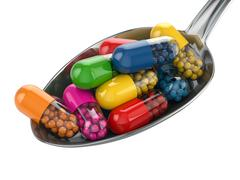 dietary supplements. variety pills. vitamin capsules on the spoon. - stock illustration