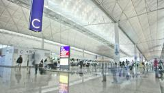 Timelapse video of travellers in the Hong Kong International Airport - stock footage