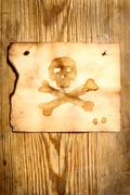 Paper with skull and crossbones - stock photo