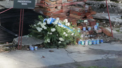 Auschwitz - flowers and candles at ruins of crematory. Stock Footage