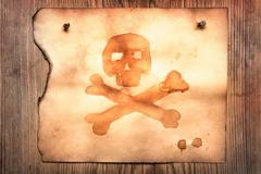 Old paper with jolly roger - stock photo