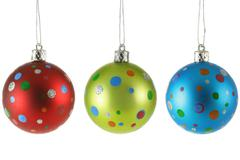 Three Christmas balls with colorful spots - stock photo