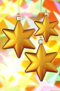 Three gold Christmas stars Stock Photos