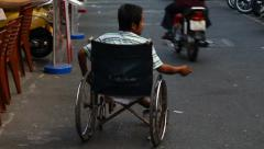 Disabled person begging on the streets of Saigon, Vietnam. - stock footage