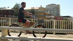 Man Riding Bicycle Along Australia Beach Stock Video Stock Footage
