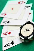 Casino chips and four aces - stock photo