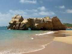 Caves and colourful rock formations on the algarve coast Stock Photos