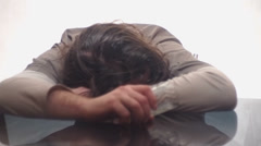 Drunkard sleeps sitting at the table Stock Footage