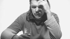 Man in doubt, drink vodka or not,black and white Stock Footage