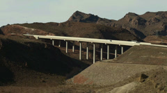 Interstate Highway Bridge Over a Desert Canyon Stock Footage