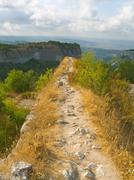 Pathway and precipice in mountains Stock Photos