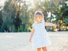 Adorable little girl at the beach Stock Photos