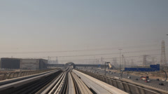 Dubai Train POV DEWA Jebel Ali Power Plant Nakheel Harbour Tower Metro Station 1 Stock Footage