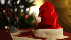 Santa Claus hat near Christmas  spruce tree decorated with New Year toys - stock footage