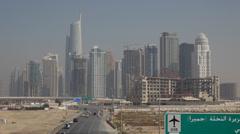 Stock Video Footage of Almas Towers Diamond Skyscraper Jumeirah Lake Free Zone Dubai Marina Car Traffic