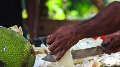 Machete cuts vegetables Stock Footage