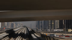 Dubai POV Metro Train Driving Approaching Jumeirah Lake Tower Station Skyscraper Stock Footage