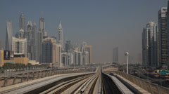 Dubai Marina POV Metro Busy City Subway View Departing Station Elevated Tracks Stock Footage