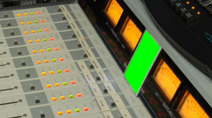 Tv radio volume control console vu meters with green screen monitor Stock Footage