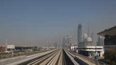 Dubai Skyline POV Metro Train Traveling Trip Ride Skyscrapers Corporate Office Stock Footage