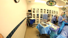 Pan left to right in operating room during surgery Stock Footage