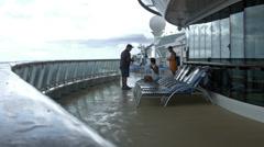 Cruise passengers on deck in rain HD BM 0931 Stock Footage