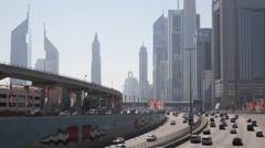 Burj Khalifa Emirates Twin Towers Dubai Skyline Rush Hour Traffic Busy Highway Stock Footage