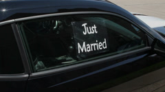 Just Married sign on window of car Stock Footage