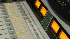 Tv radio volume control console vu meters with blinking screen monitor Stock Footage