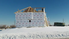 New house construction residential building in cold weather climate Stock Footage