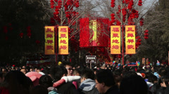 Thousands of people visit temple fair in Ditan Park Stock Footage